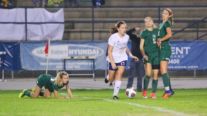 Gulf Breeze's Sydney Wood (17) leaves the Lecanto players behind as she races between them during the FHSAA class 3A state semifinal game at Gulf Breeze High School on Friday, Feb. 16, 2018. The Dolphins won 2-0 and will travel to DeLand to face Merritt Island for the state championship on Friday, Feb. 23.