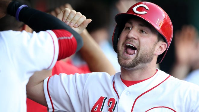 Cincinnati Reds right fielder Scott Schebler (43) celebrates after scoring a run in the first inning during a National League baseball game between the New York Mets and the Cincinnati Reds, Tuesday, May 8, 2018, at Great American Ball Park in Cincinnati.