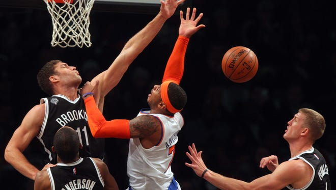 Brooklyn Nets center Brook Lopez goes up for a block against Knicks small forward Carmelo Anthony Friday night.
