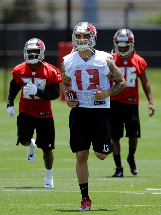 Tampa Bay Buccaneers first-round draft pick Mike Evans (13) runs during NFL football rookie camp Friday, May 16, 2014, in Tampa, Fla. Evans, the seventh pick overall, played at Texas A&M. (AP Photo/Chris O'Meara)