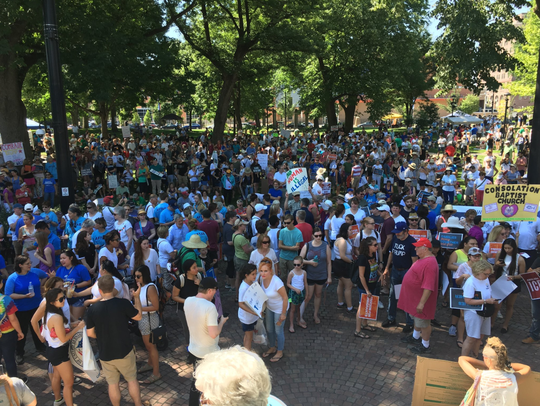 Crowds gathered last year at Washington Park in Over-the-Rhine to take part in the Families Belong Together March. A new bill from Ohio lawmakers would force local officials to assist with immigration enforcement.