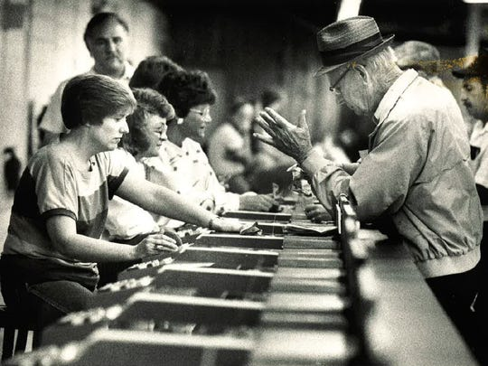 Gamblers place their bets at the betting window at the Cloverleaf Dog Track in Loveland in 1988.