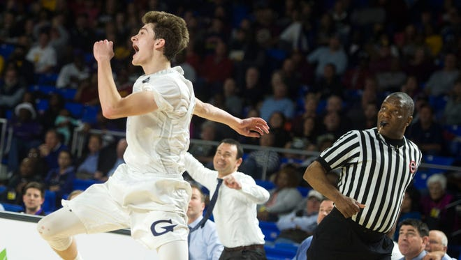 Grace Christian's C.J. Gettelfinger celebrates in the final seconds of Thursday's Class A quarterfinal game against Humboldt at Middle Tennessee State University in Murfreesboro.