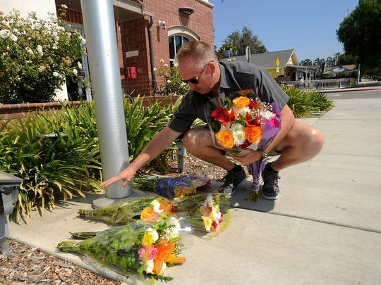Ventura County Fire Department engineer Rich Macklin drops off flowers outside Station No. 42 in Moorpark, where he works, as did fellow engineer Ryan Osler.