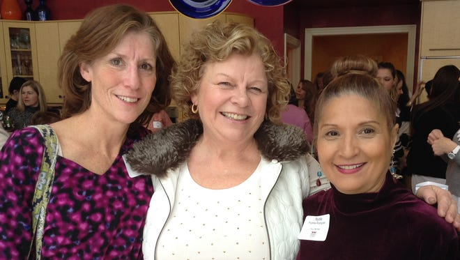 Dawn Borgeest, center, with WLC members at a WLC event in January.