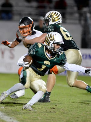 Travis Jones of Viera looks for running room during Friday's game in Viera.