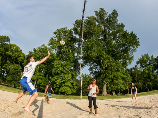 A group of Wilmington-area young professionals play volleyball at the sand courts at Bellevue State Park on Tuesday evening.