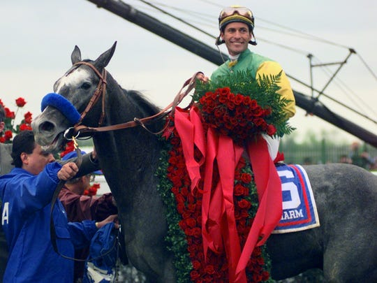Jockey Gary Stevens and Silver Charm in the winner's circle after winning the 1997 Kentucky Derby.