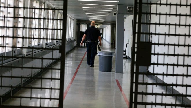 A Rikers Island juvenile detention facility officer walks down a hallway of the jail in New York.