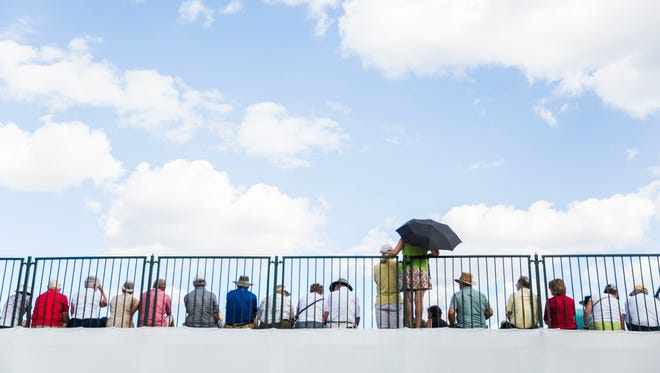 Spectators watch from the grandstands on the 18th hole has golfers begin to finish during the final day of the Chubb Classic in Naples on Sunday.