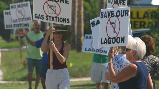 Residents in Cape Canaveral on Friday, Aug. 22, protest a proposed Cumberland Farms convenience store with gas pumps, fearing the loss of trees on the property and damage to the Indian River Lagoon from storm water runoff.