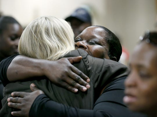 Tammy Burnett, mother of Raekwon Manigault who was one of the three victims, is hugged by prosecutor Michelle Crowley after Johnny Blackshell was found guilty of three counts of first-degree murder at the Hall of Justice.
