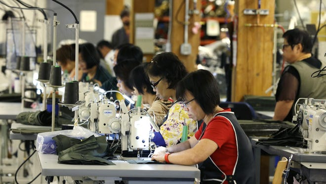 Employees work at their sewing machines in August at the C.C. Filson Co. facility in Seattle. U.S. factory employment has risen slightly since bottoming in 2010.