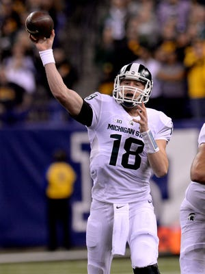 MSU quarterback Connor Cook throws downfield December, 5, 2015, in Indianapolis at the Big Ten Championship football game.