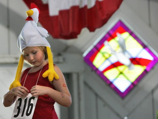 Ciara Schierkolk, 7, of Shanandoah, IA participated in the rooster calling contest at The Iowa State Fair