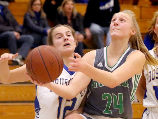 Greendale's Kayce Vaile heads up to the basket against