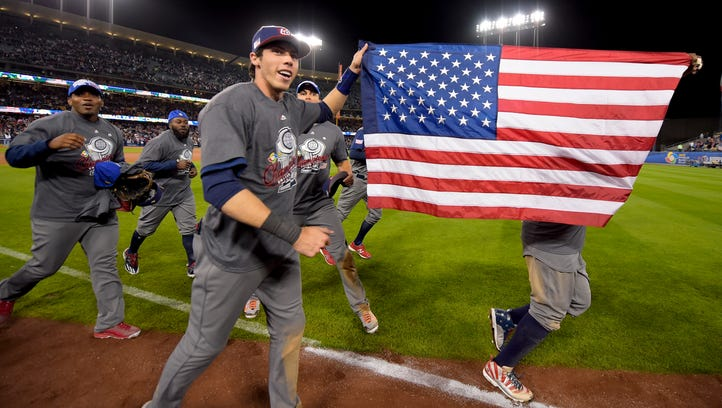 The U.S. team celebrates an 8-0 win over Puerto Rico in the final of the World Baseball Classic in Los Angeles, Wednesday, March 22, 2017. (AP Photo/Mark J. Terrill)