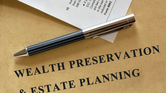 Notebook with wealth preservation and estate planning on cover.