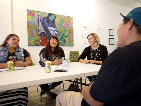 Small-business expert Pamela Slim, center right, helps