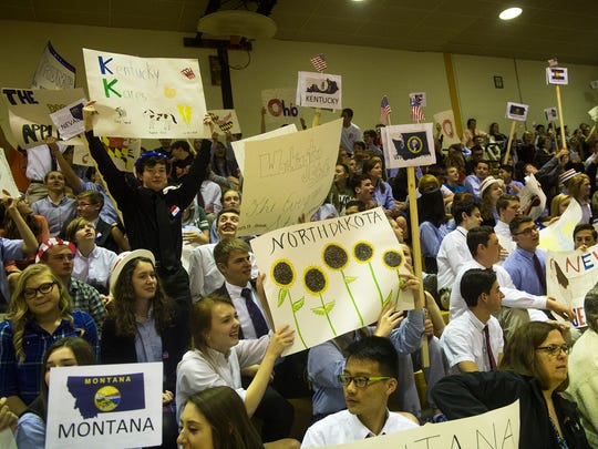 Delegates cheer and wave signs during the mock political convention at Delone Catholic High School on March 23, 2016.