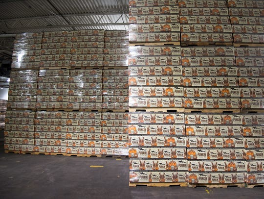Cases of Dogfish Head's Punkin Ale four-packs await
