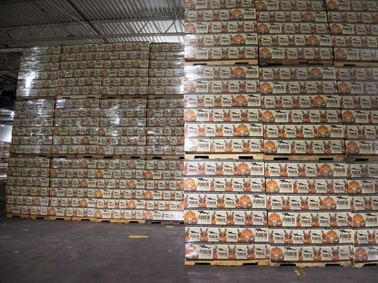 Cases of Dogfish Head's Punkin Ale four-packs await shipment at Dogfish Head Brewery in Milton last year.