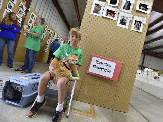 Isaac Rouer of Sturgeon Bay waits his turn with Lucky for the small pet event in the Junior Fair Face-to-Face competition at the Door County Fair in Sturgeon Bay on Thursday, Aug. 2, 2018. It was his first time showing an animal.
