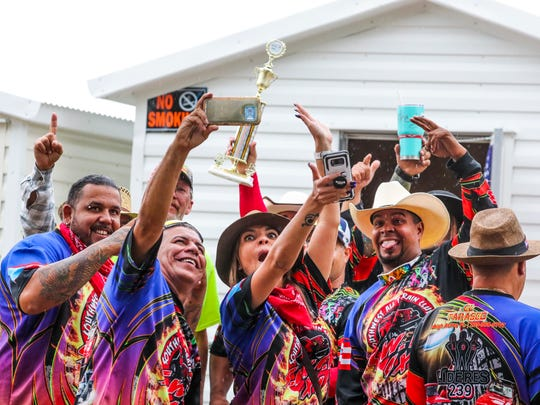 Members of the Southwest All Terrain Club celebrate with their first place trophy after winning best float in the 2018 Lehigh Spring Festival parade.