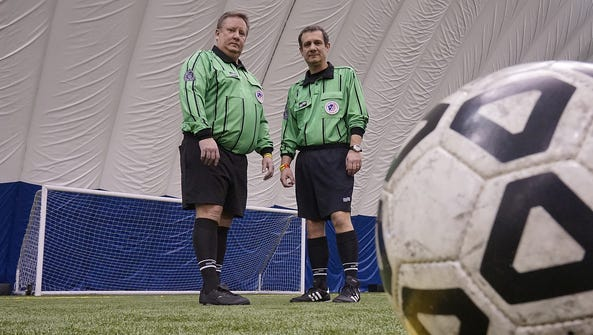 Soccer referees (from left) Kevin Winningham and Mario