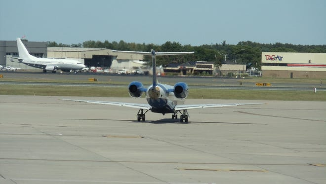 This file photo from Aug. 25, 2013, shows aircraft activity at the Bradley International Airport near Hartford, Conn.