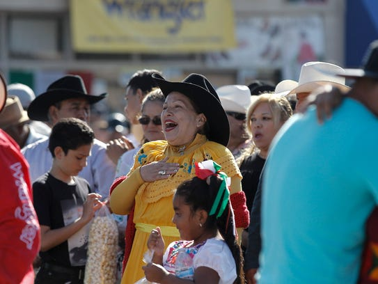 A woman reacts as Tormenta De Durango performs on stage