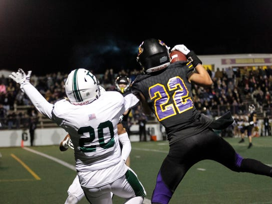 Salinas' Zachary Robison catches the pass over Palo