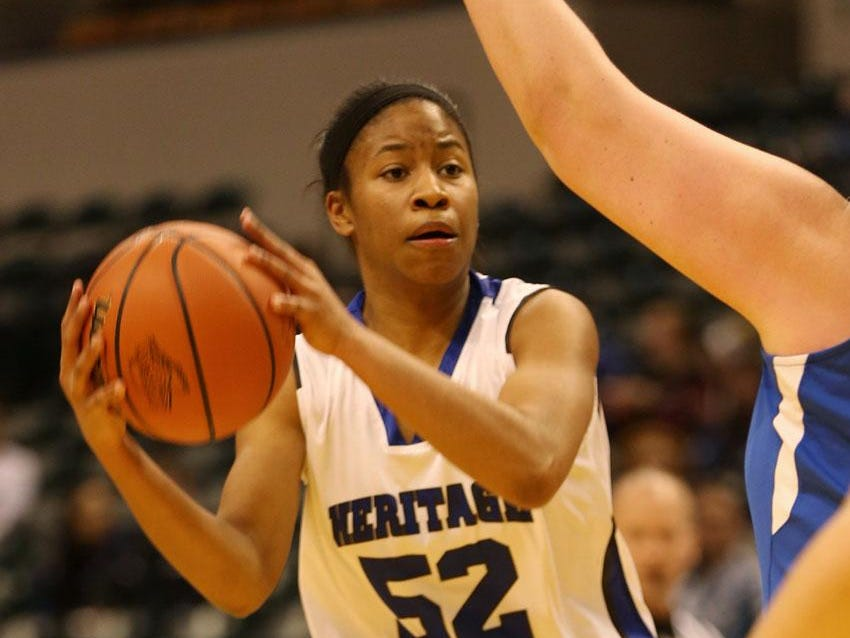 Heritage Christian's #52 Tyasha Harris moves for a shot in second half action at the IHSAA Girls Class 2A girls basketball state finals game at Bankers Life Fieldhouse, Saturday, March 7, 2015. Heritage Christian won the game against Ft. Wayne Canterbury 73-53.