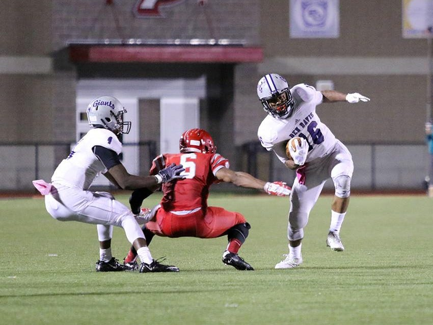 Ben Davis' Stori Emerson tries to elude a Pike defender in the Giants' 55-27 win over the Red Devils to open sectional play Friday.