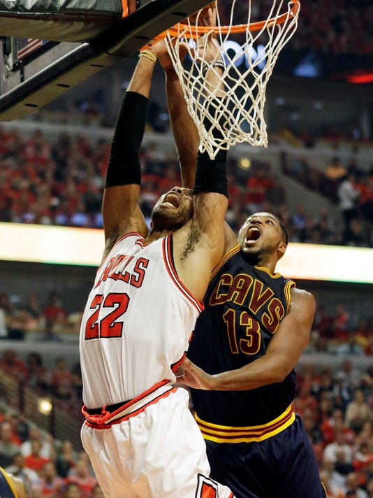 Chicago Bulls forward Taj Gibson, left, shoots past Cleveland Cavaliers forward Tristan Thompson during the second half of Game 3 in a second-round NBA basketball playoff series Friday, May 8, 2015, in Chicago. The Bulls won 99-96. (AP Photo/Nam Y. Huh)