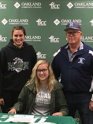 Richmond High School senior Evelyn Swantek signs her