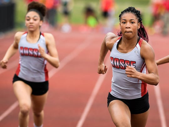 Bosse's Tionee Brigham (center) wins the girls' 100-meter dash with a time of 12.14 Friday at the City meet. She also took the 200.