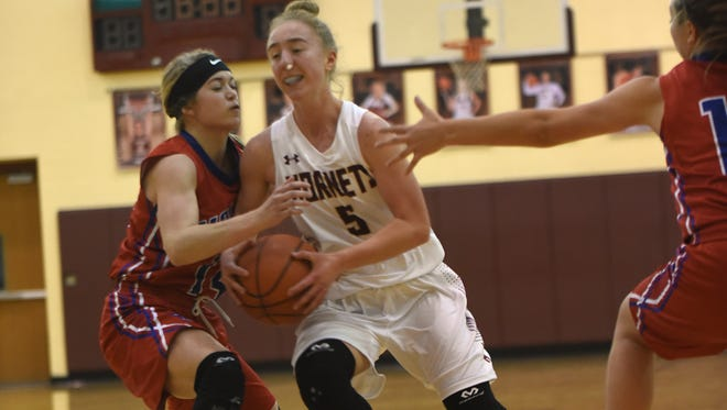 Licking Heights junior Emily Swisher fights to the basket during a game earlier this season against Licking Valley. The Hornets begin the second half of their Licking County League schedule later this week.