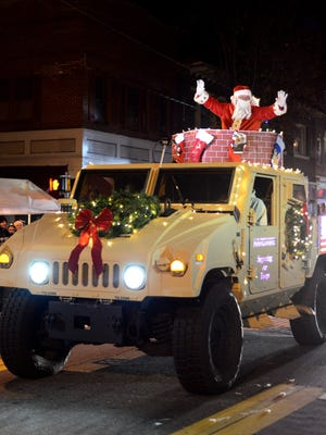 Santa Claus arrives in Pocomoke City on a military vehicle from Hardwire LLC during a past Pocomoke Christmas Parade.