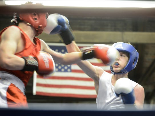 Jimmy Woodson (right) punches his opponent during the