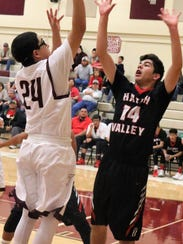 Tularosa's Ryder King tries to score in the paint while