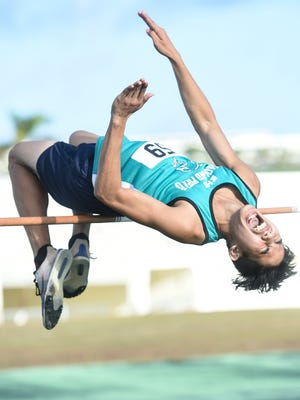 "In this file photo, Nelson Ortega of the Southern High Dolphins, clears the bar with a leap of 5'6"" in the high jump at an IIAAG track meet at John F. Kennedy High School on April 5. The All-Island Track and Field Meet starts today at JFK."