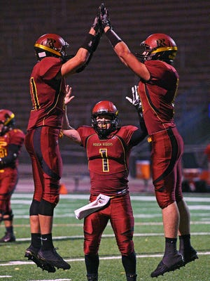 Roosevelt's Austin Johnson (81), Torren Devericks (1) and Nathan Varns (11) react after Johnson scored a touchdown during a game against Rapid City Central Friday, Oct. 14, 2016, at Howard Wood Field in Sioux Falls.