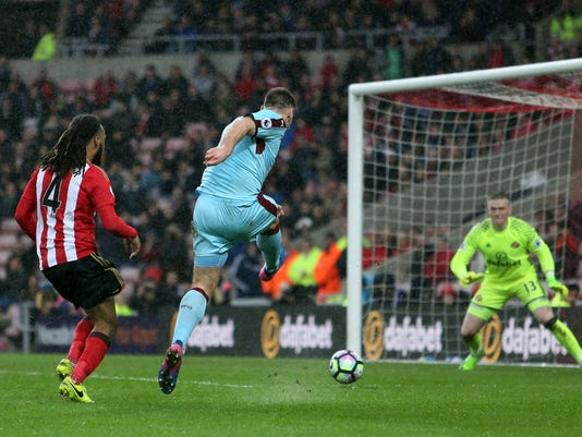 Burnley's Sam Vokes has a shot on goal, during the English Premier League soccer match between Sunderland and Burnley, at the Stadium of Light, in Sunderland, England, Saturday March 18, 2017. (Richard Sellers/PA via AP)