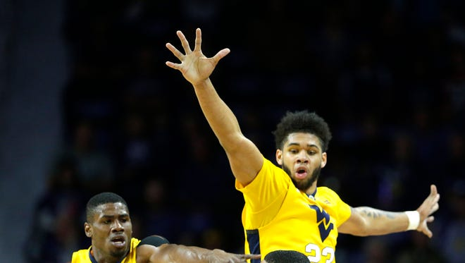 Kansas State's Justin Edwards is pressured by West Virginia's Jonathan Holton (1) and Esa Ahmad (23).