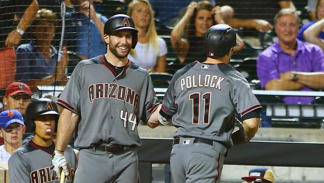 Aug 21, 2017: Arizona Diamondbacks center fielder A.J. Pollock (11) is congratulated by first baseman Paul Goldschmidt (44) after hitting a game winning two run home run against the New York Mets during the tenth inning at Citi Field.