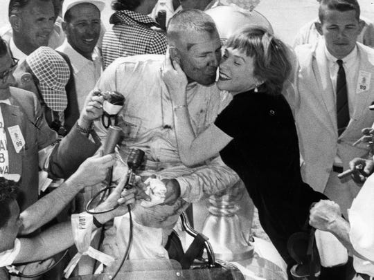 Shirley MacLaine prepares for a victory kiss with 1958 Indianapolis 500 winner Jimmy Bryan.