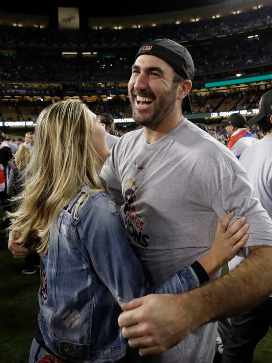 Houston Astros' Justin Verlander celebrates with Kate Upton after Game 7 of baseball's World Series against the Los Angeles Dodgers Wednesday, Nov. 1, 2017, in Los Angeles. The Astros won 5-1 to win the series 4-3. (AP Photo/Matt Slocum)