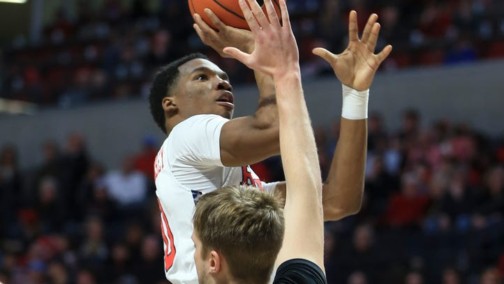 Ole Miss guard Donte Fitzpatrick-Dorsey (20) shoots the ball against Vanderbilt Commodores center Josh Henderson (40) during the first half at The Pavilion at Ole Miss.
