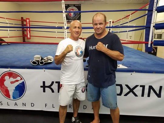 Josh Collins (right) with David DiQuollo of Unlimited Kickboxing in Merritt Island.